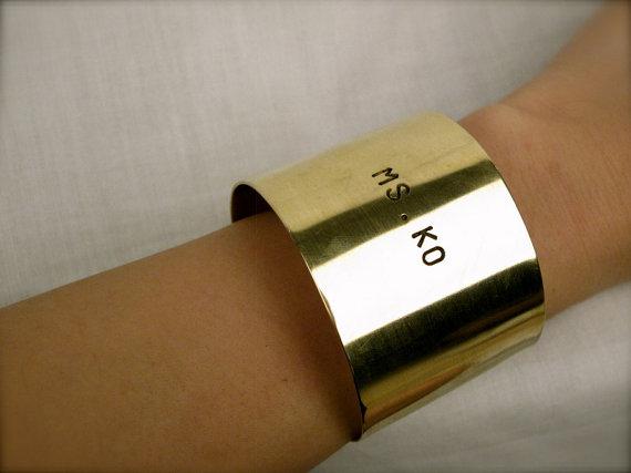 Customized Mno.logie gold wrist cuff
